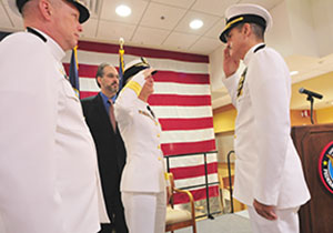Adm. Elaine C. Wagner, Commander of Navy Medicine East and Naval Medical Center Portsmouth salutes Capt. José A. Acosta, new Commanding Officer and Deputy Director of the Captain James A. Lovell Federal Health Care Center.  Capt. David J. Beardsley former Deputy Director and Jeffrey Murawsky, M.D.,