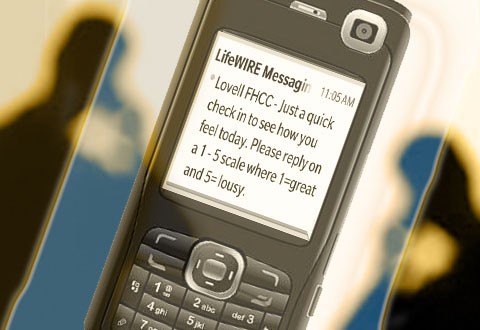 Two people on cell phone and image of cell phone with text message,