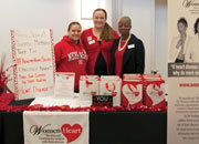 Lovell FHCC's new WomenHeart Champions man an information table