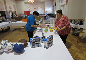 Karen Nelson, from the Libertyville American Legion Ladies Auxiliary, on the left, and Sandy Nys, from the Gurnee Auxiliary, put out items for the holiday shop.